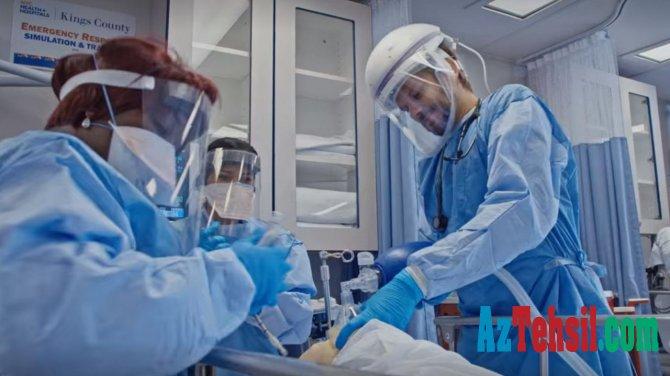 """Koronavirus xəstələrini müalicə edən həkim: """"Bir aydır övladımı görmürəm"""" - VİDEO"""